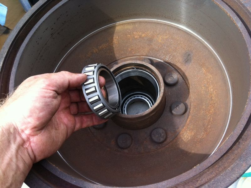 How far to back off the bearing retaining nut on rear axle?